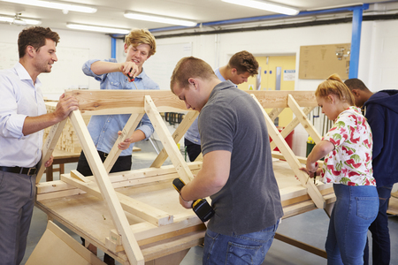 Teacher Helping College Students Studying Carpentry Stock Photo - 85401051