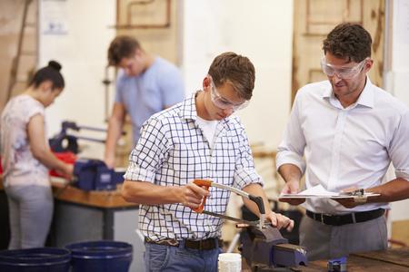 Teacher Helping College Students Studying Plumbing Imagens