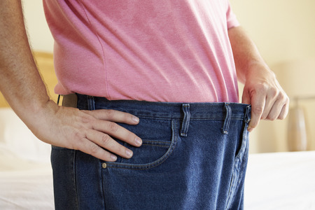 Close Up Of Man On Diet Losing Weight From Waist