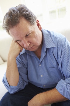 middle aged man: Depressed Overweight Man Sitting On Sofa