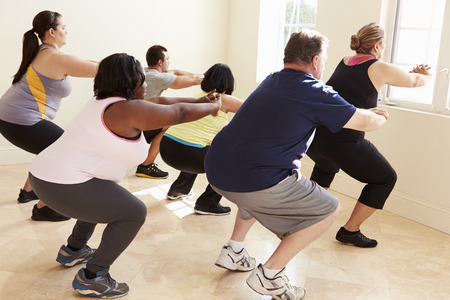 exercises: Fitness Instructor In Exercise Class For Overweight People
