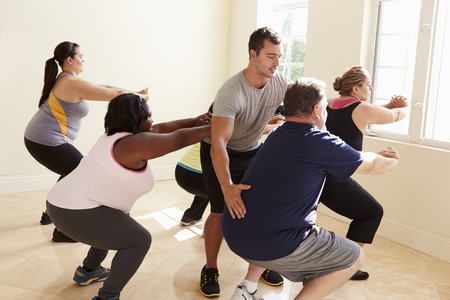 fat person: Fitness Instructor In Exercise Class For Overweight People