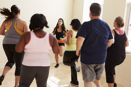and the horizontal man: Fitness Instructor In Exercise Class For Overweight People