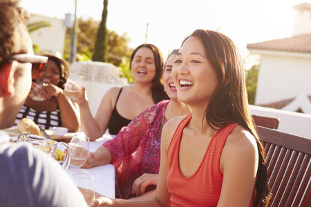 Couple Enjoying Outdoor Summer Meal With Friends photo