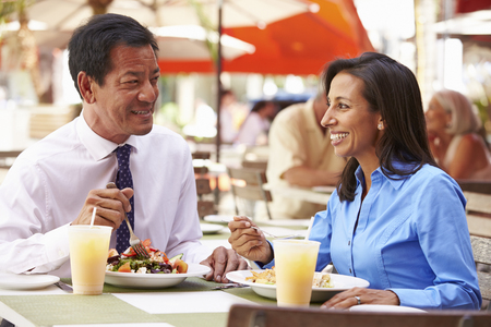 Two Businesspeople Having Meeting In Outdoor Restaurant photo