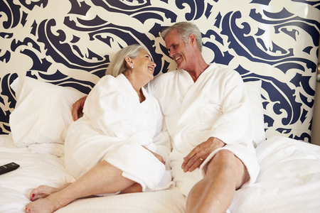toweling: Senior Couple Relaxing In Hotel Room