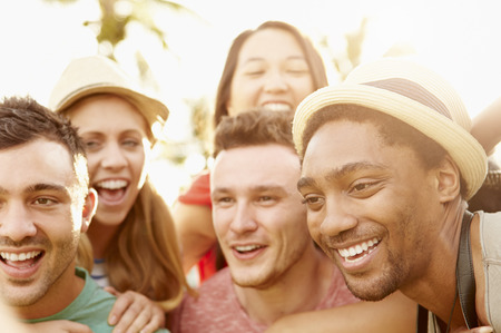 multi ethnic groups: Group Of Friends Having Fun In Park Together Stock Photo