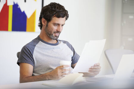 casually dressed: Casually Dressed Man Working In Design Studio Stock Photo