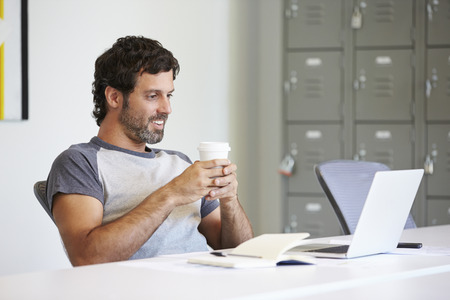 casually: Casually Dressed Man Working In Design Studio Stock Photo