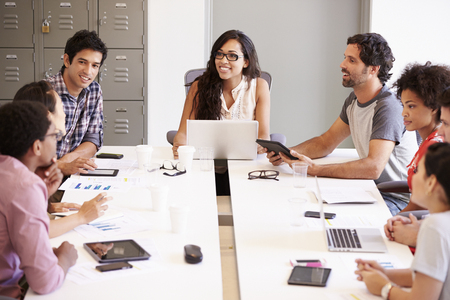collaborating: Designers Meeting To Discuss New Ideas Stock Photo
