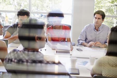 through window: Designers Having Meeting Viewed Through Window