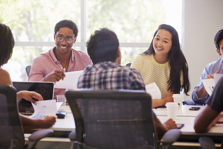 casual: Designers Meeting To Discuss New Ideas Stock Photo