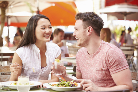Couple Enjoying Lunch In Outdoor Restaurant Stock Photo