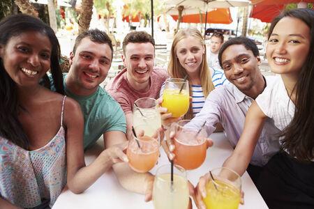 bar: Group Of Friends Enjoying Drinks In Outdoor Restaurant