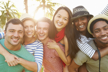 Group Of Friends Having Fun In Park Together Stock Photo