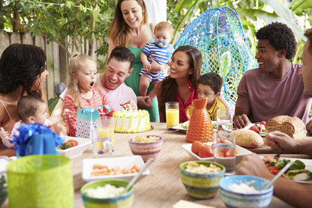 3 6 months: Group Of Families Celebrating Childs Birthday At Home Stock Photo