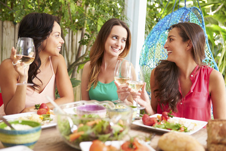 Three Female Friends Enjoying Meal Outdoors At Home Stock Photo - 33614067