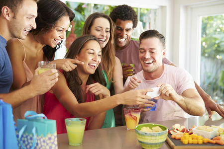 Group Of Friends Taking Selfie Whilst Celebrating Birthday photo