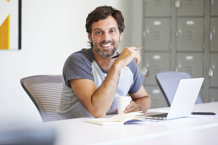 design studio: Casually Dressed Man Working In Design Studio Stock Photo