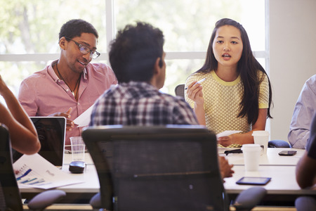 cultural: Designers Meeting To Discuss New Ideas Stock Photo