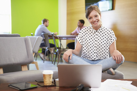 taking a break: Woman Taking A Break Working In Design Studio Stock Photo