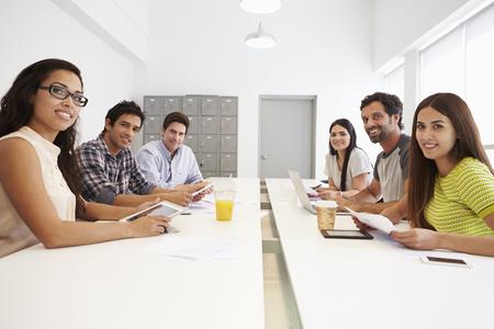 Portrait Of Hispanic Designers Meeting To Discuss New Ideas photo