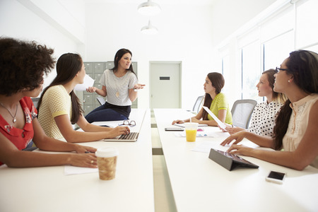 Group Of Women Working Together In Design Studio Stock Photo