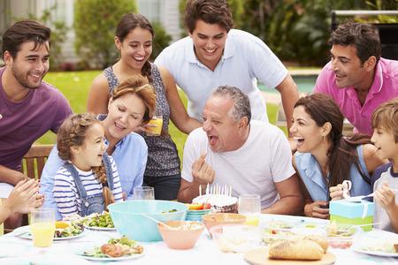 hispanics: Multi Generation Family Celebrating Birthday In Garden