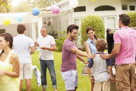 backyard: Multi Generation Family Enjoying Party In Garden Together