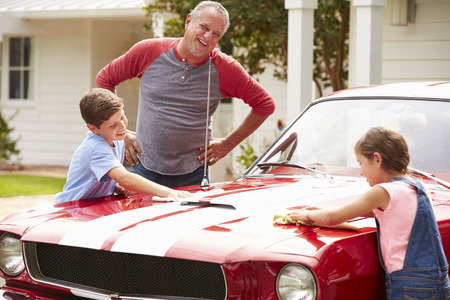 restoring: Grandfather With Grandchildren Cleaning Restored Classic Car