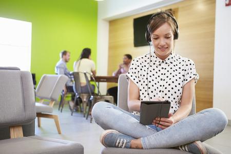 Woman Taking A Break Working In Design Studio photo