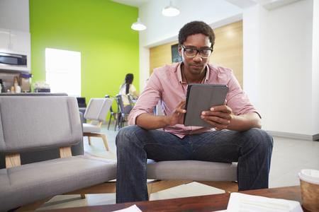 modern sofa: Man Taking A Break Working In Design Studio