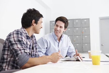 collaborating: Two Men Working Together In Design Studio Stock Photo