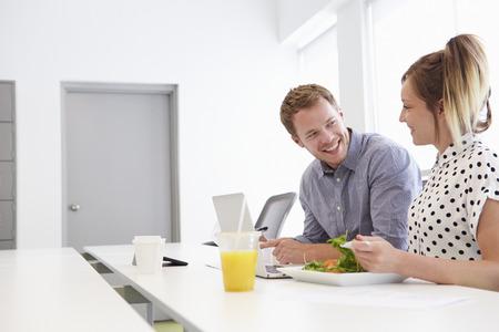 design studio: Creatives Having Working Lunch In Design Studio Stock Photo
