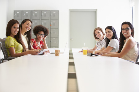 collaborating: Portrait Of Women Working Together In Design Studio Stock Photo