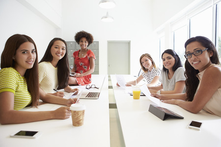 multi cultural: Portrait Of Women Working Together In Design Studio Stock Photo