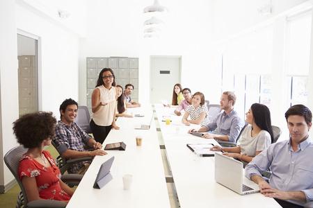 collaborating together: Design Team Collaborating On Project Together
