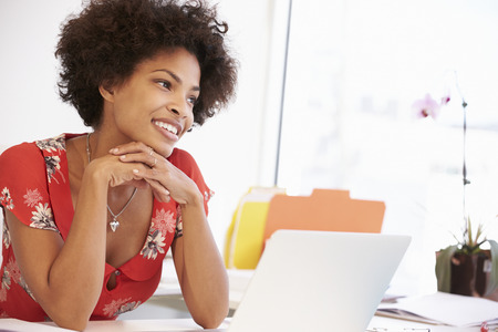 african american woman business: Woman Working At Desk In Design Studio Stock Photo