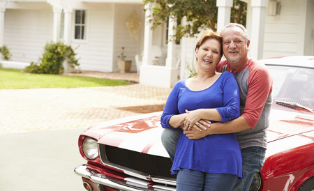 Senior Couple With Restored Classic Car Stock Photo