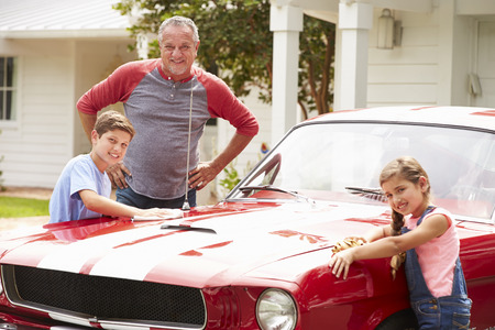 11 years: Grandfather With Grandchildren Cleaning Restored Classic Car