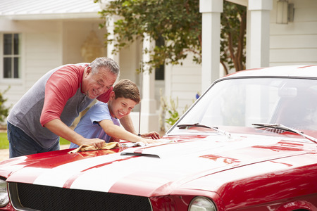 grandson: Grandfather And Grandson Cleaning Restored Classic Car