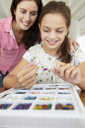 Mother and daughter making jewellery