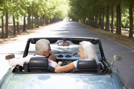 top down car: Senior couple in sports car