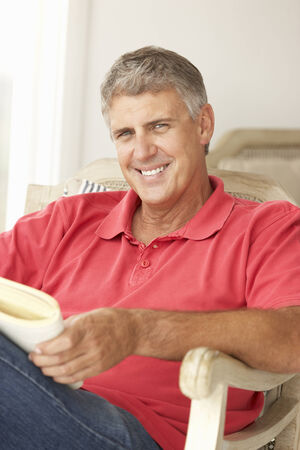 mid age: Mid age man reading a book Stock Photo