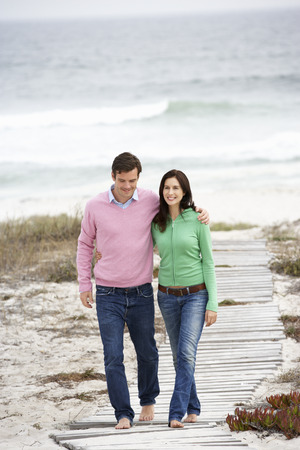 arms around: Couple walking by the sea