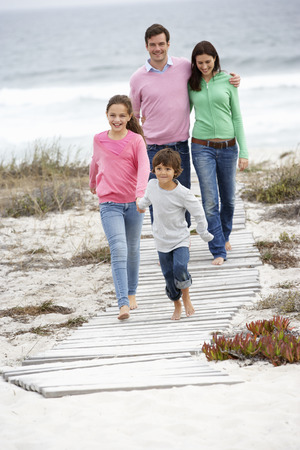 arms around: Family walking by the sea