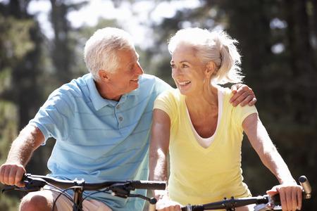 elderly exercise: Senior couple on bicycles