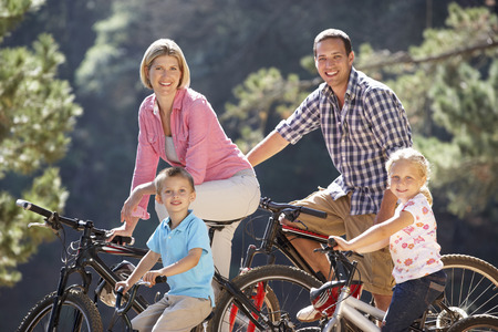 45 years old: Young family on country bike ride Stock Photo