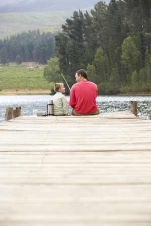 sons and grandsons: Father and son fishing Stock Photo