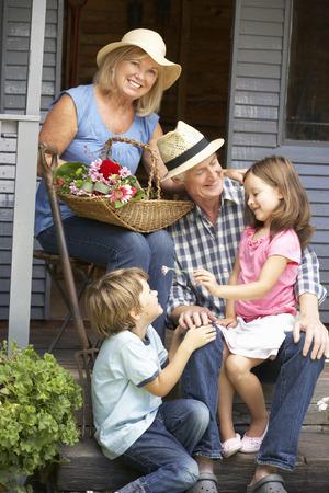 45 years old: Senior couple on veranda with grandchildren